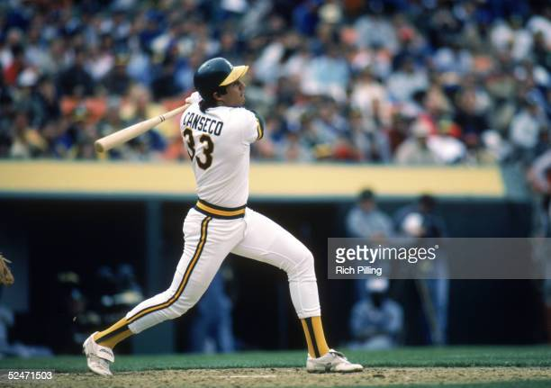 Jose Canseco of the Oakland Athletics swings at the pitch during a 1986 season game at OaklandAlameda County Stadium in Oakland California