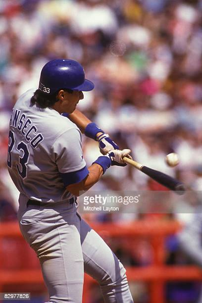 Jose Canseco of the Texas Rangers bats during a baseball game against the Milwaukee Brewers on May 1 1993 at Milwaukee County Stadium in Milwaukee...