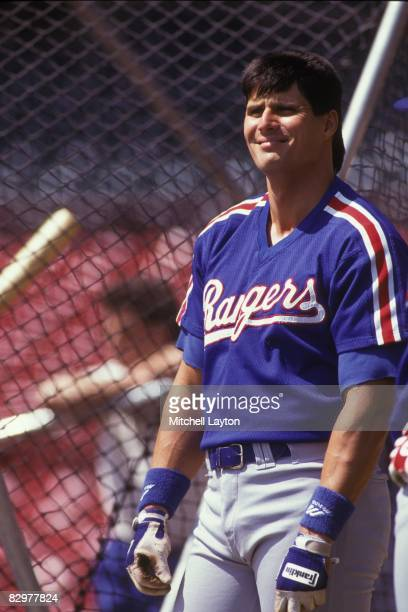 Jose Canseco of the Texas Rangers before a baseball game against the Milwaukee Brewers on May 1 1993 at Milwaukee County Stadium in Milwaukee...