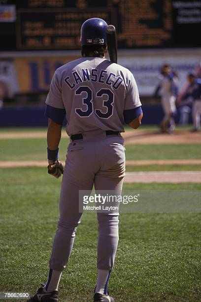 Jose Canseco of the Texas Rangers during a baseball game against the Milwaukee Brewers on April 15 1993 at Milwaukee County Stadium in Milwaukee...