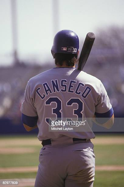 Jose Canseco of the Texas Rangers during a baseball game against the Milwaukee Brewers on May 1 1993 at Milwaukee County Stadium in Milwaukee...