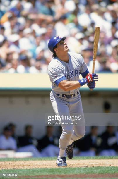 Jose Canseco of the Texas Rangers follows the flight of the ball during a 1993 season game Jose Canseco played for the Rangers from 19921994