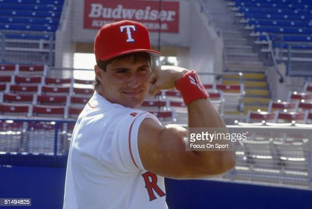 Jose Canseco of the Texas Rangers hams it up for the camera at Charlotte County Stadium on 1994 in Port Charlotte, Florida.