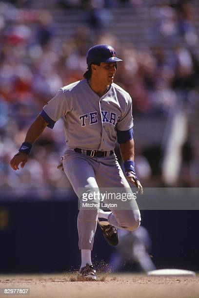 Jose Canseco of the Texas Rangers leads off second base a baseball game against the Milwaukee Brewers on May 1 1993 at Milwaukee County Stadium in...