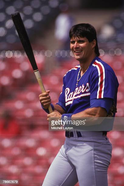 Jose Canseco of the Texas Rangers looks on before a baseball game against the Milwaukee Brewers on April 15 1993 at Milwaukee County Stadium in...