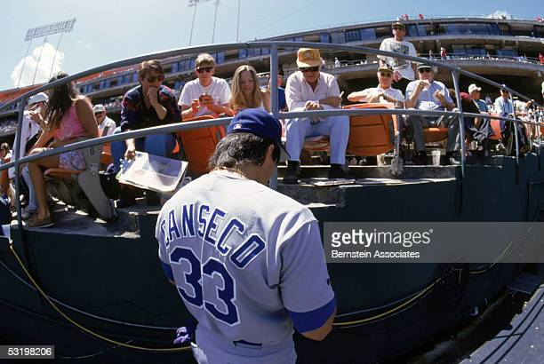 Jose Canseco of the Texas Rangers signs autographes for fans before a 1993 season game Jose Canseco played for the Rangers from 19921994