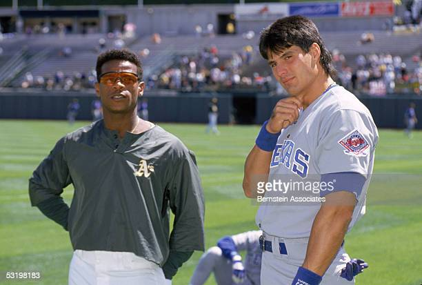 Jose Canseco of the Texas Rangers stands with Rickey Henderson of the Oakland Athletics before a 1993 season game Jose Canseco played for the Rangers...