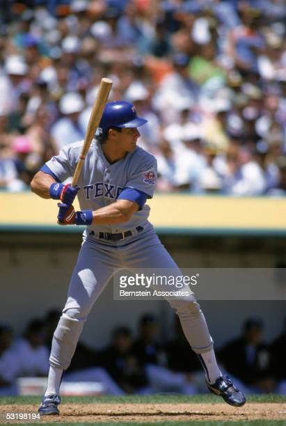 Jose Canseco of the Texas Rangers steps into the swing during a 1993 season game Jose Canseco played for the Rangers from 19921994