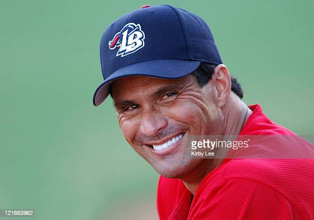 Jose Canseco watches from the dugout during his debut with the Long Beach Armada in the Golden League Baseball game against the Reno Silver Sox at...