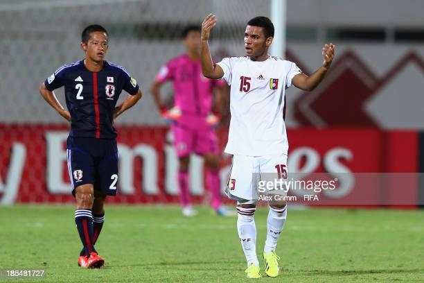 Jose Caraballo of Venezuela celebrates his team's first goal as Ryoma Ishida of Japan reacts during the FIFA U-17 World Cup UAE 2013 Group D match...