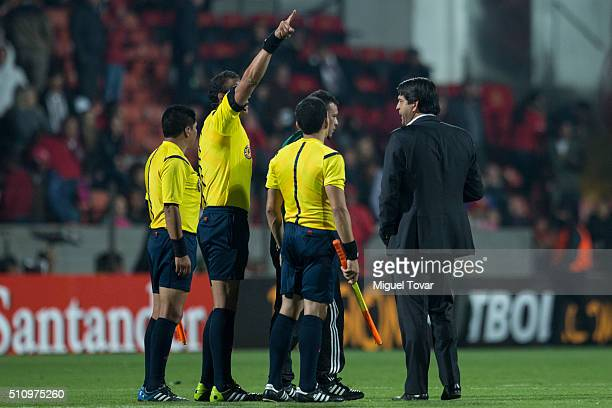 Jose Cardoso coach of Toluca discusses with the referee during the group 6 match between Toluca and Gremio as part of Copa Libertadores 2016 at...