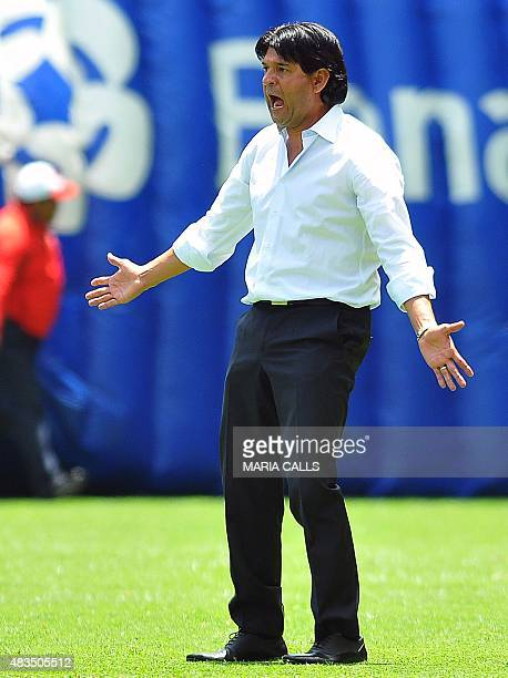 Jose Cardoso, coach of Toluca, gestures during their Mexican Apertura 2015 tournament football match against Toluca in Toluca, Mexico, on August 9,...
