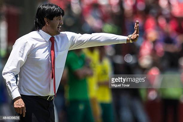 Jose Cardoso coach of Toluca reacts during a match between Toluca and Leon as part of the 15th round Clausura 2014 Liga MX at Nemesio Diez Stadium on...