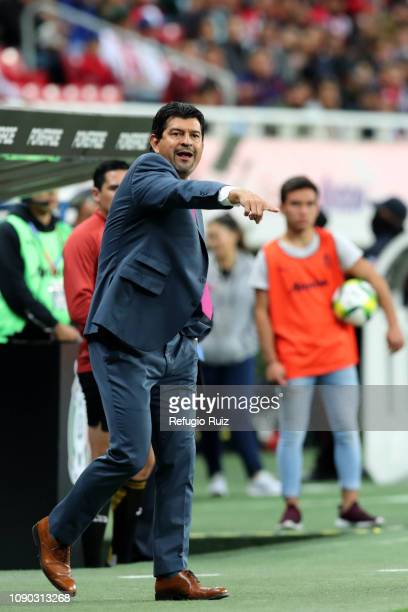 Jose Cardozo, coach of Chivas gives instructions to his players during the first round match between Chivas and Tijuana as part of the Torneo...