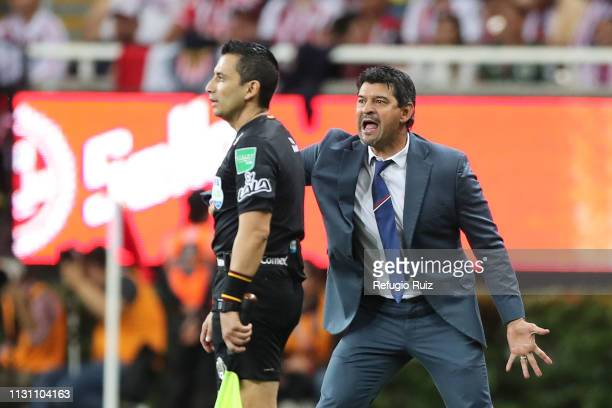 Jose Cardozo coach of Chivas gives instructions to his players during the 11th round match between Chivas and America as part of the Torneo Clausura...
