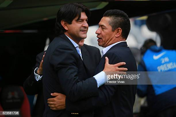 Jose Cardozo coach of Toluca and Ignacio Ambriz Coach of America embrace prior the 15th round match between America and Toluca as part of the...