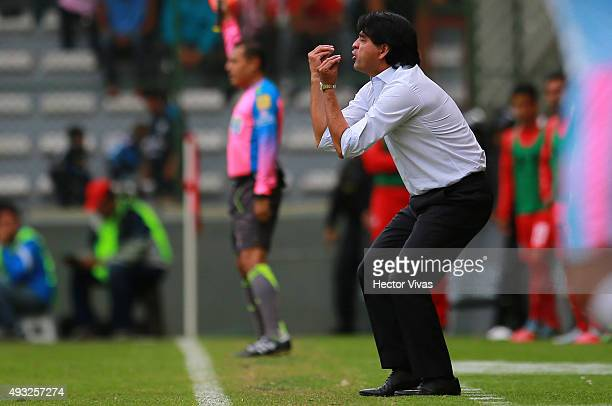 Jose Cardozo head coach of Toluca gestures during the 13th round match between Toluca and Queretaro as part of the Apertura 2015 Liga MX at Nemesio...