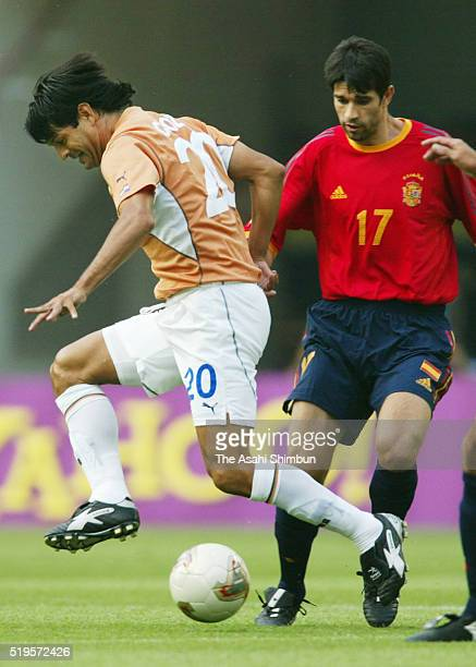 Jose Cardozo of Paraguay and Juan Carlos Valeron of Spain compete for the ball during the FIFA World Cup Korea/Japan Group B match between Spain and...