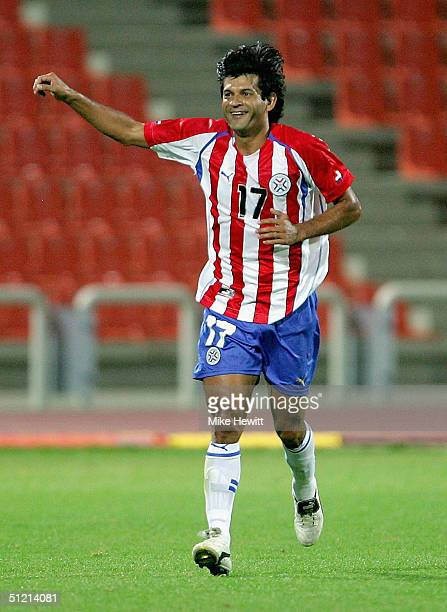 Jose Cardozo of Paraguay celebrates his second goal in the men's football semifinal match between Iraq and Paraquay on August 24 2004 during the...