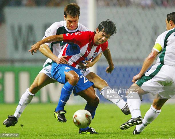 Jose Cardozo of Paraguay controls the ball under pressure of Spasoje Bulajic of Slovenia during the FIFA World Cup Korea/Japan Group B match beteen...