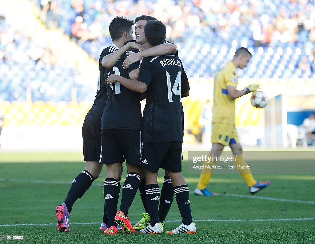 Jose Carlos Lazo (2L) of Real Madrid Academy celebrates with team mates after scoring their team's third goal during the UEFA Youth Champions League match between PFC Ludogorets Razgrad and Real Madrid at Georgi Asparuhov Stadion on October 1, 2014 in Sofia, Bulgaria.