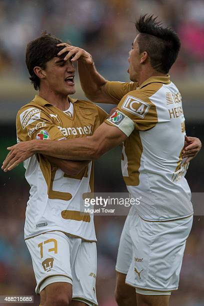 Jose Carlos Van Rankin of Pumas celebrates after scoring with Efrain Velarde during the Quarterfinal second leg match between Pumas UNAM and Pachuca...