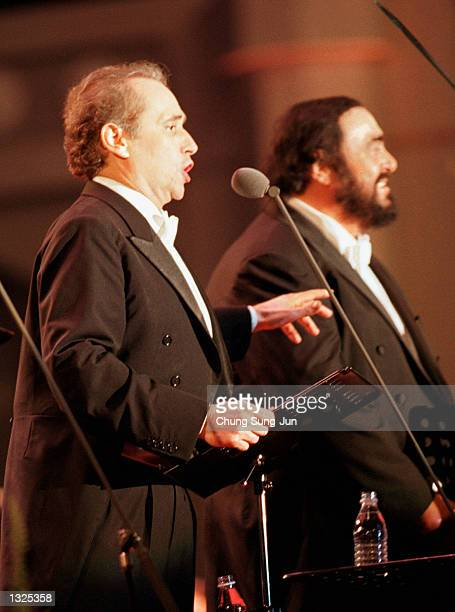 Jose Carreras left and Luciano Pavarotti sing during the Three Tenors'' concert June 22 2001 at Chamsil Olympic stadium in Seoul The concert was held...