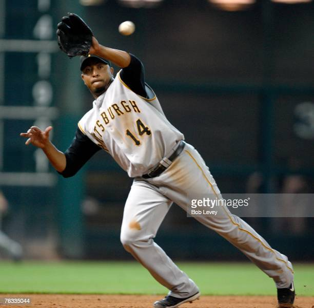 Jose Castillo of the Pittsburgh Pirates knocks down a hard hit ball by Mark Loretta of the Houston Astros in the eighth inning on August 26 2007 at...
