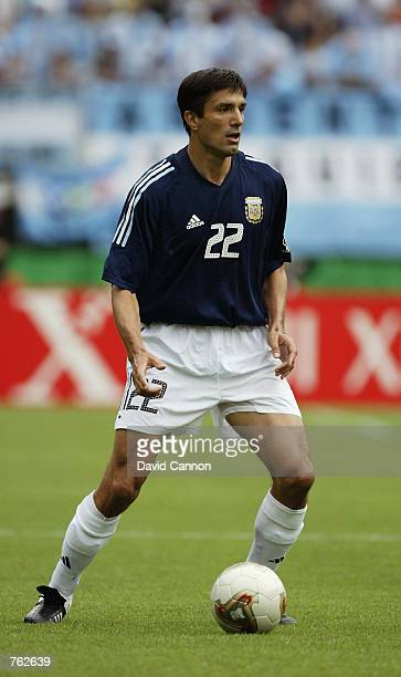 Jose Chamot of Argentina runs with the ball during the FIFA World Cup Finals 2002 Group F match between Argentina and Sweden played at the Miyagi...