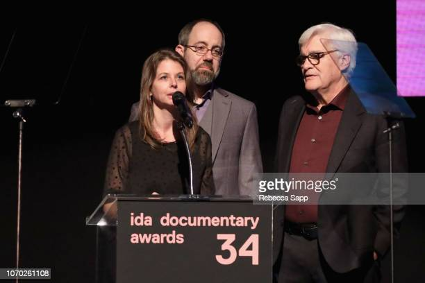 Jose 'Chato' Galante Almudena Carracedo Robert Bahar winners of the Pare Lorentz award for 'The Silence of Others' speak onstage during the 2018 IDA...