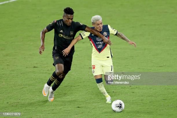 Jose Cifuentes of Los Angeles FC and Jose Cifuentes of Club America fight for the ball during the CONCACAF Champions League semifinal game at...