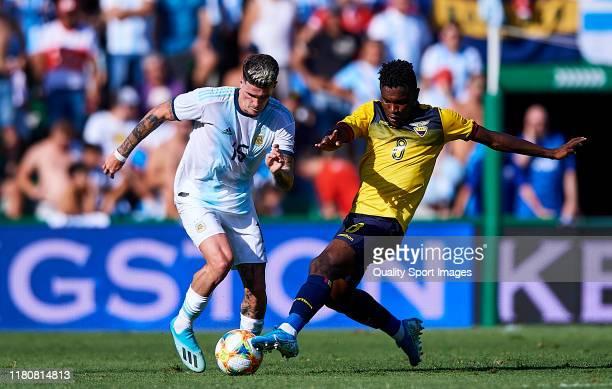 Jose Cifuentes of the Ecuador competes for the ball with Rodrigo De Paul of Argentina during the international friendly match between Ecuador and...