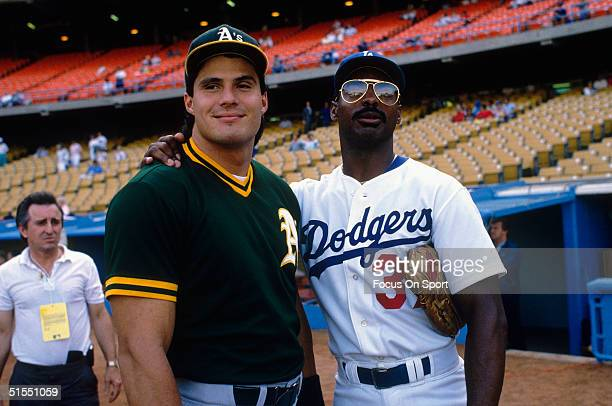 Jose Conseco of the Oakland Athletics and Mike Davis of the Los Angeles Dodgers former teammates pose before the competition during the World Series...