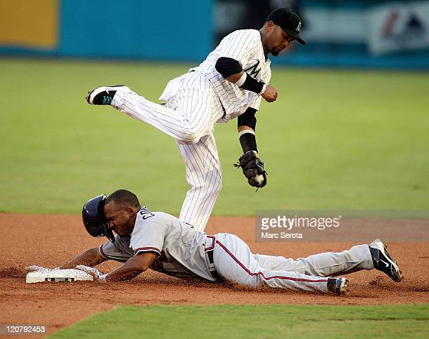 Jose Constanza of the Atlanta Braves steals second base against Emilio Bonifacio of the Florida Marlins at Sun Life Stadium on August 10 2011 in...