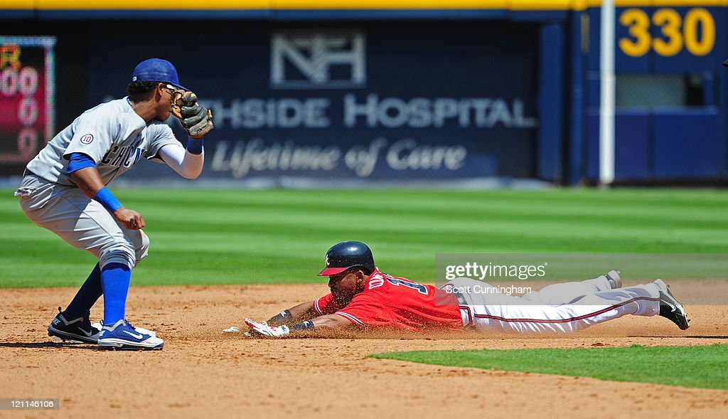 Jose Constanza #17 of the Atlanta Braves steals second base against Starlin Castro #13 of the Chicago Cubs at Turner Field on August 14, 2011 in Atlanta, Georgia.