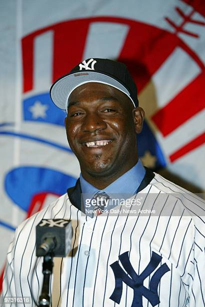 Jose Contreras the New York Yankees' new $32 million Cuban pitcher is beaming at his introduction at Yankee Stadium