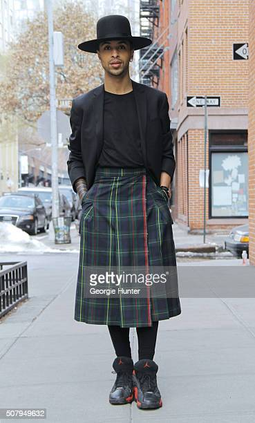 Jose Cordero seen at Industria Superstudios wearing red and black Nike Jordan sneakers green tartan JMR kilt Aquascutum black blazer jacket Nixon...