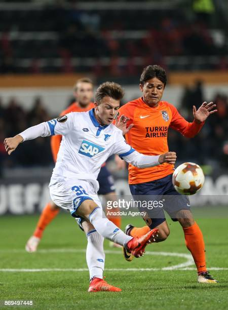 Jose Costa of Medipol Basaksehir in action against Dennis Geiger of Hoffenheim during the UEFA Europa League Group C soccer match between Medipol...