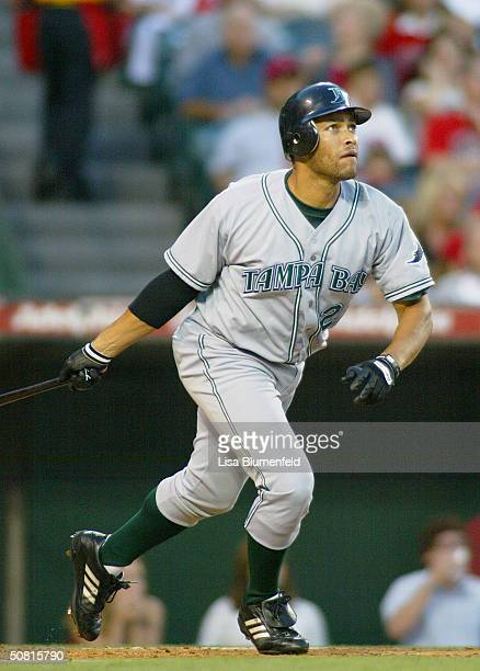 Jose Cruz Jr #22 of the Tampa Bay Devil Rays watches his homerun in the first inning against the Anaheim Angels on May 8 2004 at Angel Stadium in...