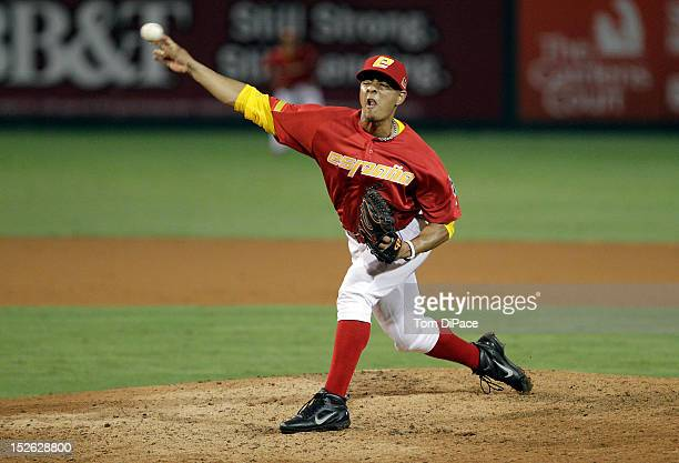 Jose Cruz of Team Spain pitches against Team France during game 2 of the Qualifying Round of the 2013 World Baseball Classic at Roger Dean Stadium on...