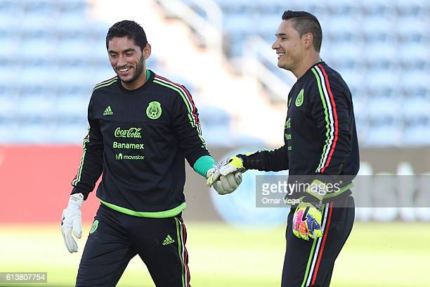 Jose de Jesus Corona and Moises Munoz goalkeepers of Mexico laugh during a training session at Toyota Park on October 10 2016 in Chicago United States