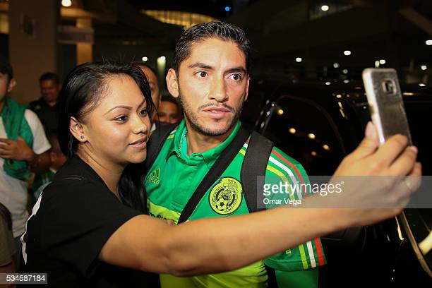Jose de Jesus Corona of Mexico poses with a fan for a selfie during the Mexico National Team arrival to United States at HartsfieldJackson...