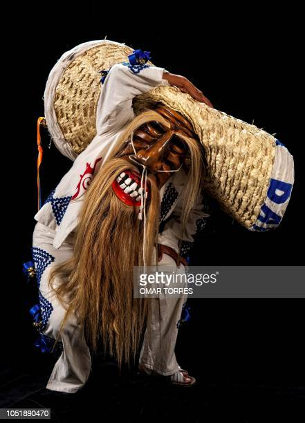 Jose Diaz Martinez poses for a photograph with his traditional costume during the presentation of the Huey Atlixcayotl Festival on September 29 2018...