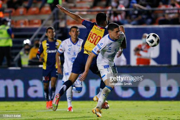 Jose Doldan of Queretaro struggles for the ball with Ricardo Alba of Atletico San Luis during their second round match in the Torneo Grita Mexico A21...