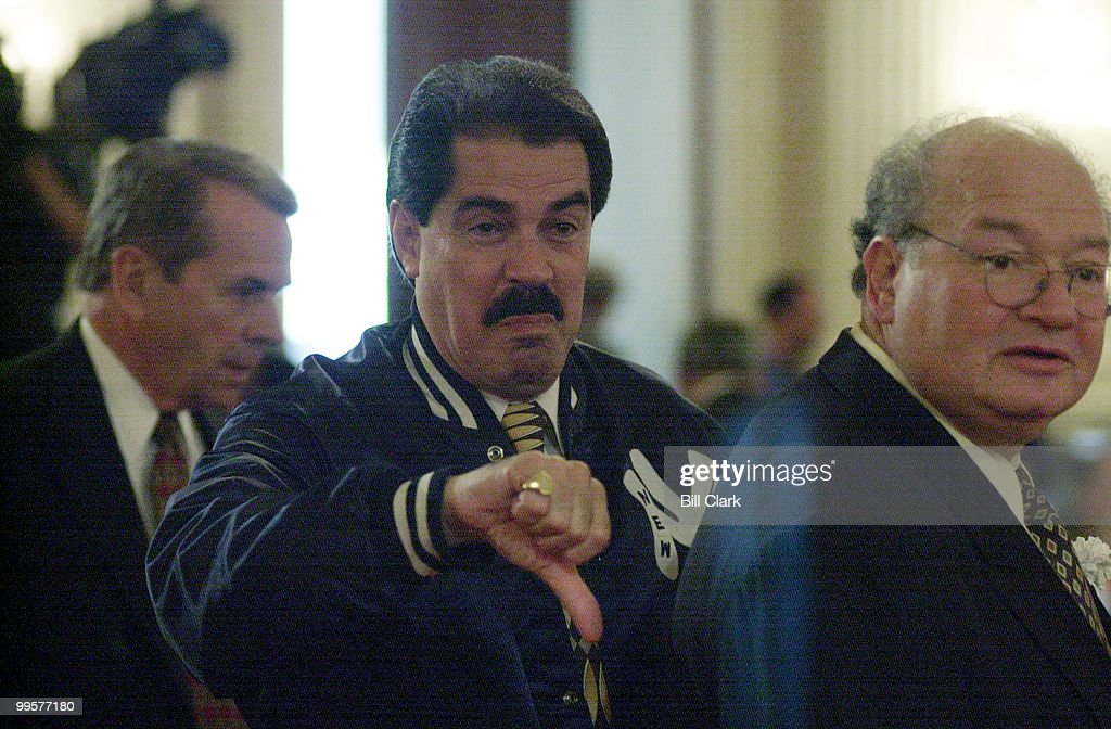 Jose E. Serrano, D-N.Y., wearing his N.Y. Yankees jacket during President Bill Clintons speech to Congressional democrats in the Canon House Office Building on Capitol Hill. Serrano's thumbs down was in response to comments made by Gary L. Ackerman, D-N.Y., about the Mets winning the World Series.