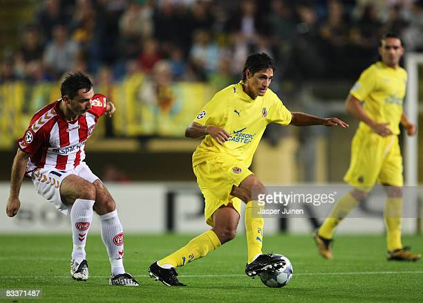 Jose Edmilson of Villarreal duels for the ball with Marek Saganowski of Aalborg during the UEFA Champions League Group E match between Villarreal and...