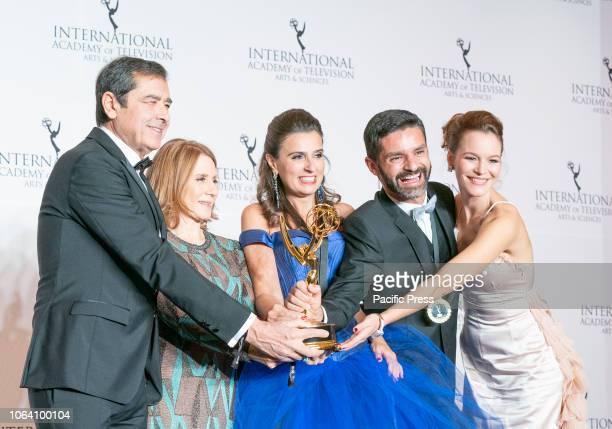Jose Eduardo Moniz and Maria Joao Costa and crew winner for the Telenovela Award during the 46th International Emmy Awards at Hilton hotel