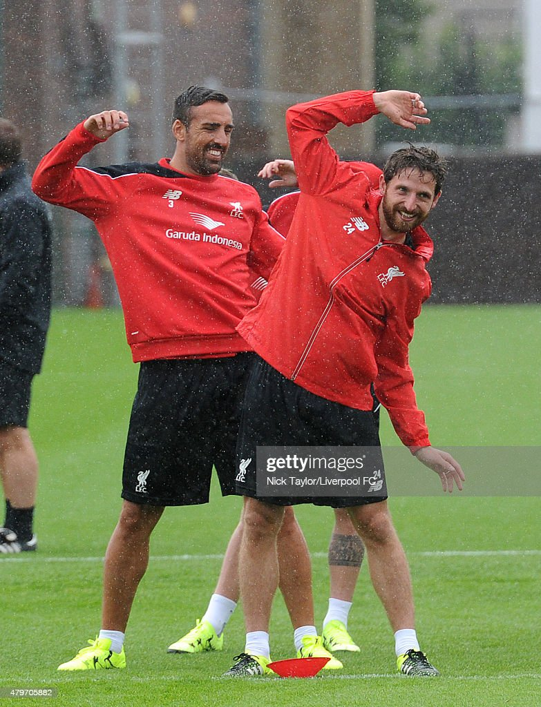 Jose Enrique and Joe Allen warm up as Liverpool players return for pre-season training at Melwood Training Ground on July 6, 2015 in Liverpool, England.