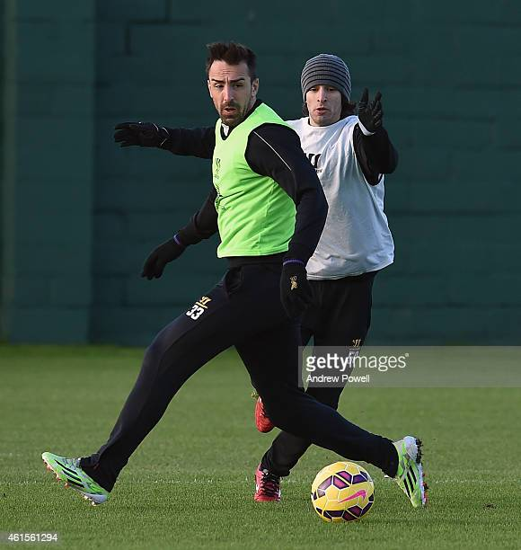 Jose Enrique and Lazar Markovic of Liverpool in action during a training session at Melwood Training Ground on January 15 2015 in Liverpool England
