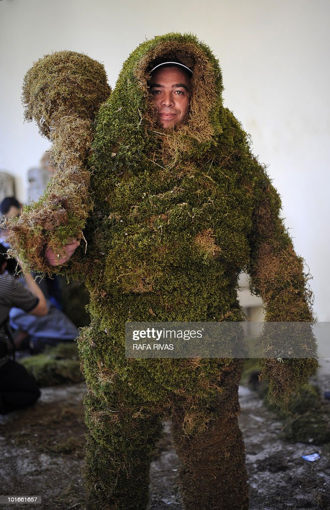 Jose Enrique Castellano, poses dressed as an 'Hombre de Musgo' (Moss Man) before taking part in the Corpus Christi procession on June 6, 2010, in the Spanish village of Bejar, Salamanca province. The Moss Men have been taking part in the Corpus Christi procession since 1397. AFP PHOTO/Rafa Rivas